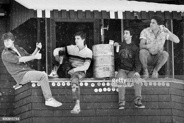 Boston College sophomores John Beisel Craig Morse John Connelly and freshman Mark Cyr sit on the porch of their house at Lake Street in the Brighton...
