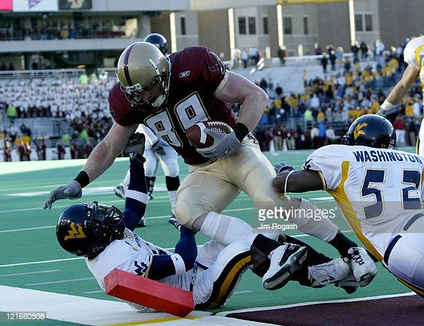 Boston College tight end Sean Ryan powers his way into the end zone against West Virginia defenders during a game between the Boston College Eagles...