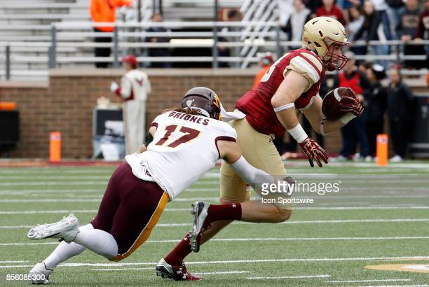 Boston College tight end Tommy Sweeney turns up field after a catch as Central Michigan linebacker Alex Briones moves in during a game between the...