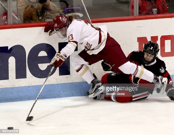 Boston College's Andiie Anastos and Northeastern University's Lauren Kelly tangle along the boards during the Women's Beanpot hockey championship...