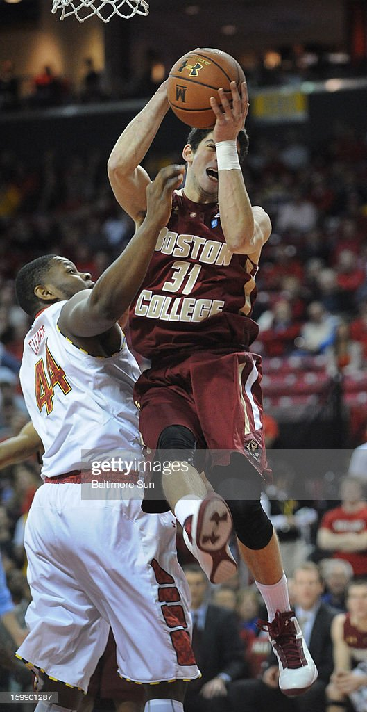 Boston College's Danny Rubin (31) grabs a first-half rebound over Maryland's Shaquille Cleare at Comcast Center in College Park, Maryland, on Tuesday, January 22, 2013.