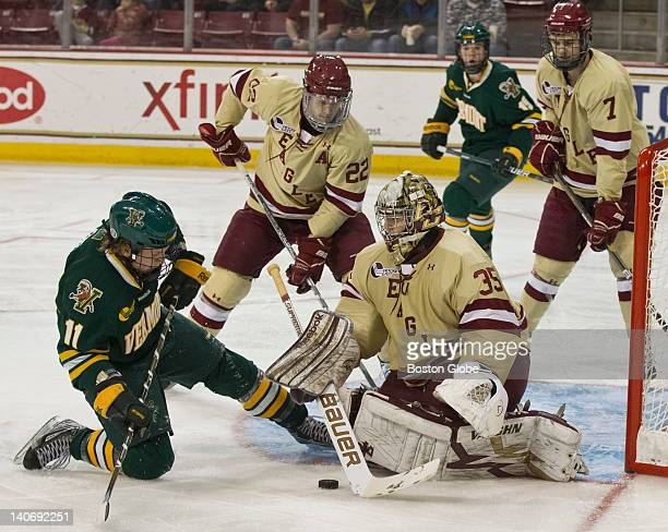 Boston College's goalie Parker Milner blocks University of Vermont's HT Lenz's shot on the goal during second period action at Conte Fourm on...