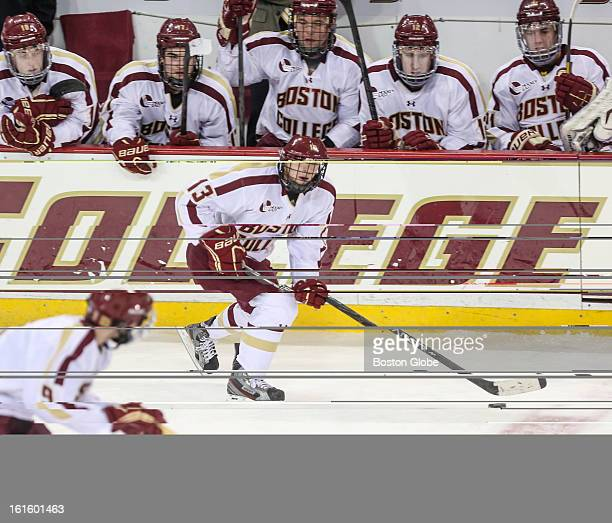 Boston College's Johnny Gaudreau skates past the Boston College bench during a hockey game between Boston College and the University of Vermont at...