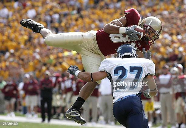 Boston College's Kevin Challenger catches a pass against the defense of Maine's Manauris Arias at Alumni Stadium Chestnut Hill Massachusetts Saturday...