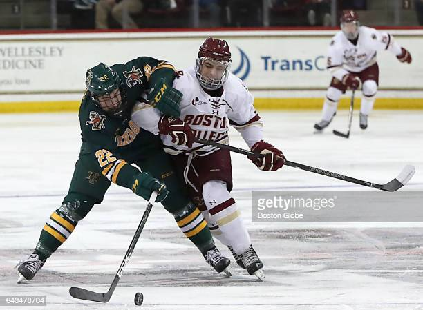 Boston College's Luke McInnis battles with University of Vermont's Brad Shaw for control of the puck during the second period Boston College hosts...
