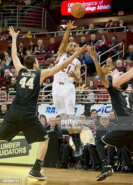 Boston College's Olivier Hanlan delivers a pass with pressure from Wake Forest's Konstantinos Mitoglou left and Madison Jones right during second...