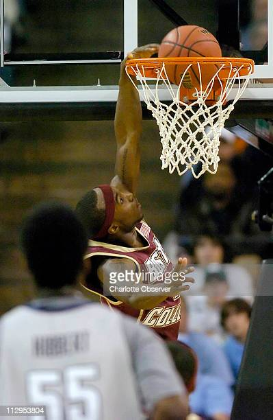 Boston College's Tyrese Rice gets a breakawy dunk past past Georgetown as Roy Hibbert looks on in the first half of a NCAA East regional second round...