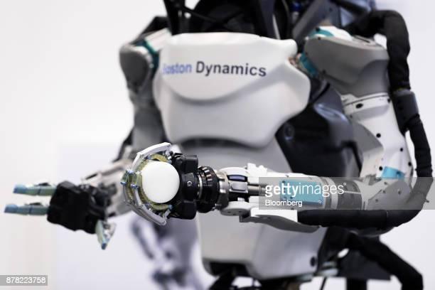 A Boston Dynamics Inc Atlas humanoid robot is displayed at the SoftBank Robot World 2017 in Tokyo Japan on Tuesday Nov 21 2017 SoftBank Chief...