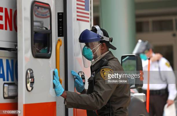 Boston EMS wear PPE while responding to remove an elderly patient from Sherrill House a nursing home in Jamaica Plain in Boston on April 14 2020