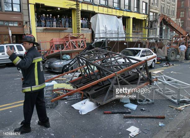 Boston firefighter directs a recuse vehicle to the scene after a construction accident on Boylston Street near Emerson College left possibly three...