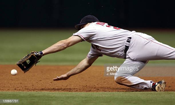 Boston first baseman Kevin Youkilis is just short on this play during Friday night's action against Tampa Bay at Tropicana Field in St Petersburg...