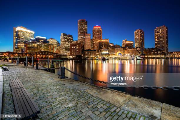 boston harbor and financial district at night in boston, massachusetts, usa. - boston stock pictures, royalty-free photos & images