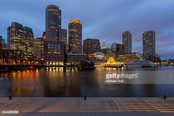 Boston Harbor. City skyline after sunset.
