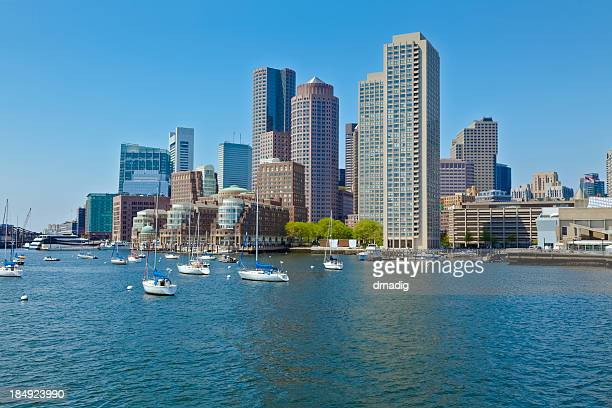 Boston Harbor Cityscape with Anchored Sailboats