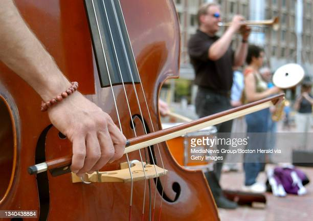 Boston, MA-- About 100 musicians, inluding bassist Blake Newman of Cambridge, left, and trumpeter Paul Tomashefsky of Shrewsbury, participate in...