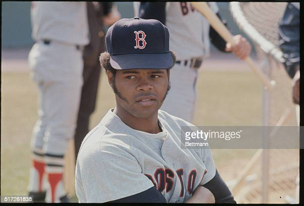 Boston Red Sox outfielder Reggie Smith The baseball player is shown in a stadium in uniform and with a baseball bat in one pose