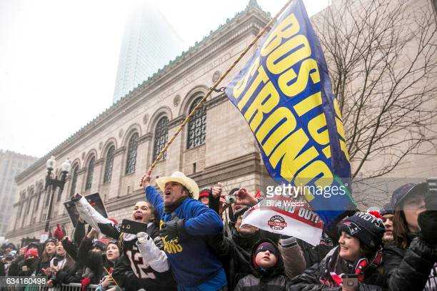 Boston Marathon bombing hero Carlos Arredondo watches the New England Patriots Super Bowl victory parade on February 7 2017 in Boston Massachusetts...