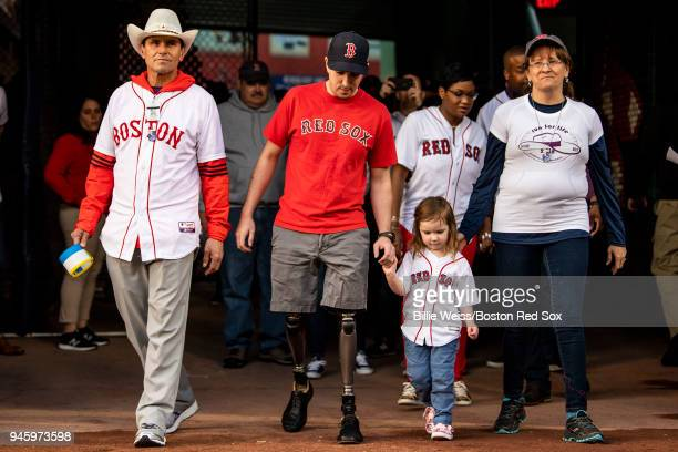 Boston Marathon bombing rescuer Carlos Arredondo and his wife Melida and survivors Jeff Bauman and Nicole Simmonds are introduced during a ceremony...