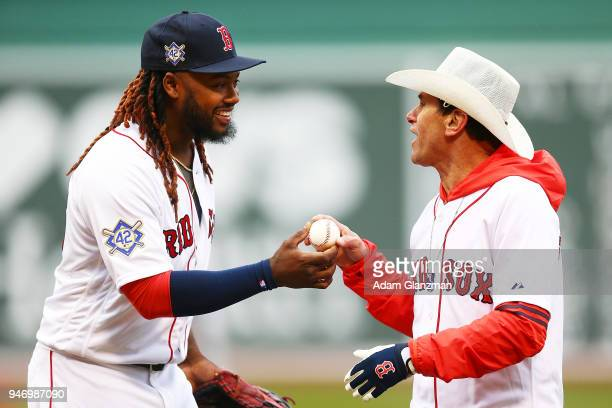Boston Marathon bombing rescuer Carlos Arredondo is greeted by Hanley Ramirez of the Boston Red Sox after throwing out the ceremonial first pitch...