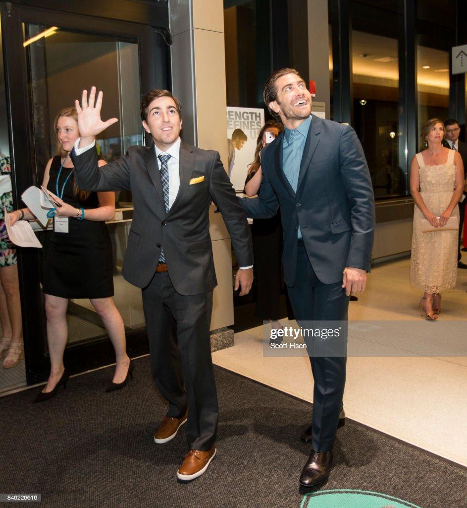 Boston Marathon Bombing survivor Jeff Bauman and actor Jake Gyllenhaal wave to patients at the Boston Premiere of STRONGER at Spaulding Rehab Center on September 12, 2017 in Charlestown, Massachusetts.