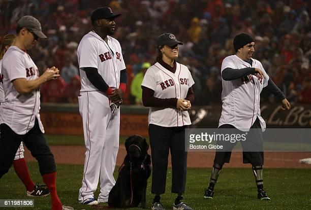 Boston Marathon Bombing survivor Jeff Bauman and other Boston marathon survivors thew out the ceremonial first pitch The Boston Red Sox take on the...