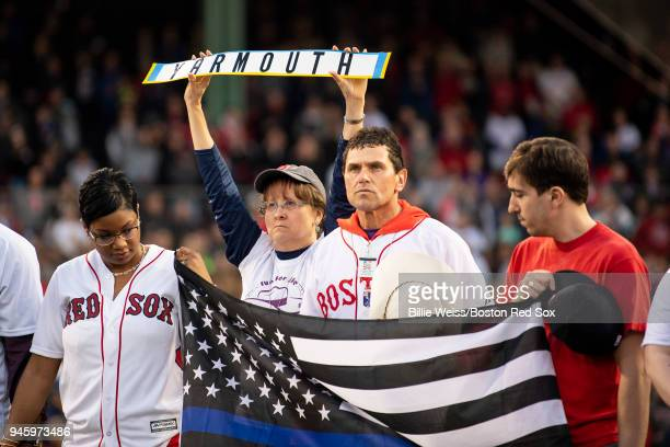 Boston Marathon bombing survivor Jeff Bauman his rescuer Carlos Arredondo and his wife Melida recognize a moment of silence is held for Yarmouth...