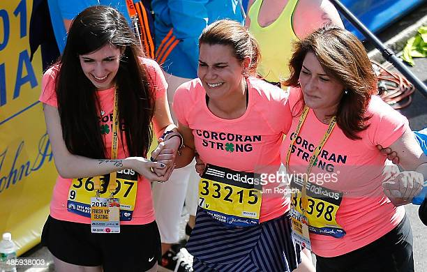 Boston Marathon Bombing survivors Celeste Corcoran and her daughter Sydney Corcoran react after crossing the finish line with Celeste's sister Carmen...