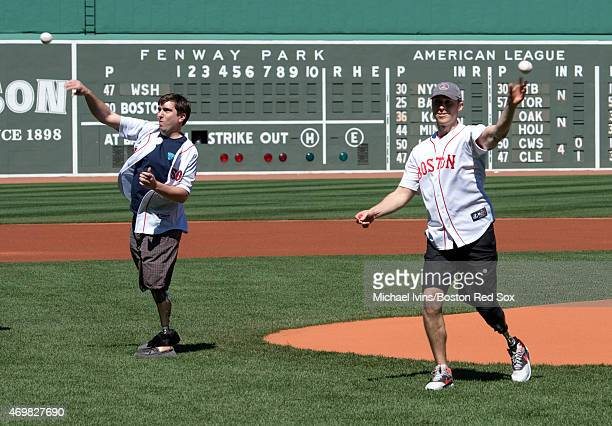 Boston Marathon bombing survivors Jeff Bauman left and Patrick Downes throw out ceremonial first pitches before the start of a game between the...