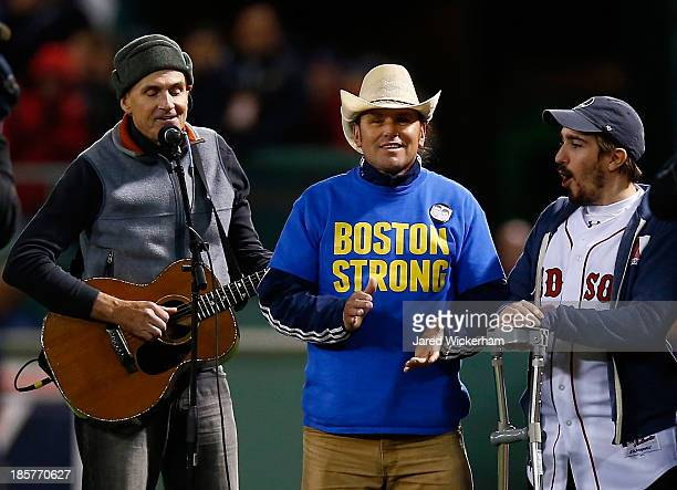 Boston marathon bombing survivors Jeff Bauman take the field during the seventh inning stretch during Game Two of the 2013 World Series between the...