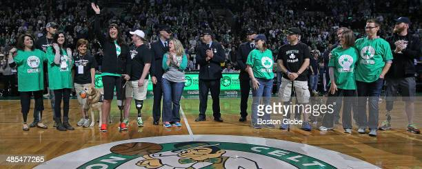 Boston Marathon bombing survivors were honored at mid court following the end of the first quarter The Boston Celtics hosted the Washington Wizards...