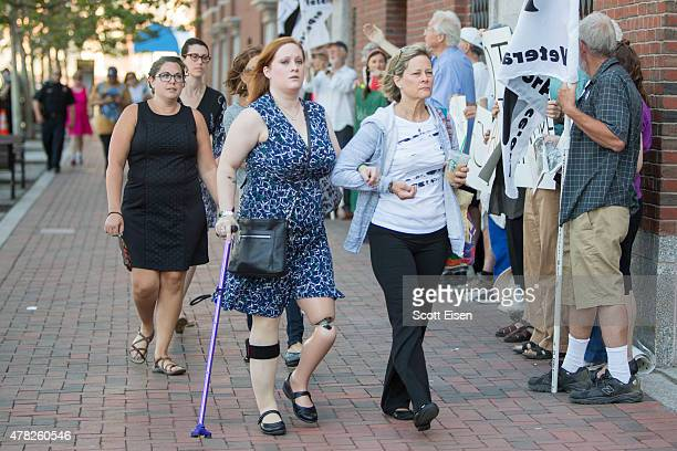 Boston Marathon Bombing victim Erika Brannock front left arrives with her mother Carol Downing at John Joseph Moakley United States Courthouse for...