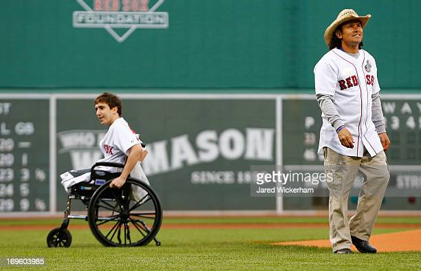 Boston Marathon bombing victim, Jeff Bauman and Carlos Arredondo , the man who came to his aid immediately following the explosions, throw out the...
