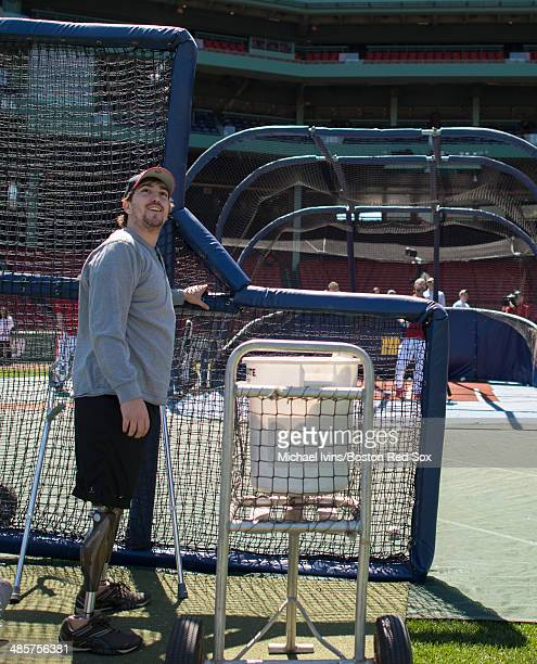 Boston Marathon bombing victim Jeff Bauman helps throw batting practice for David Ross of the Boston Red Sox before the game against the Baltimore...