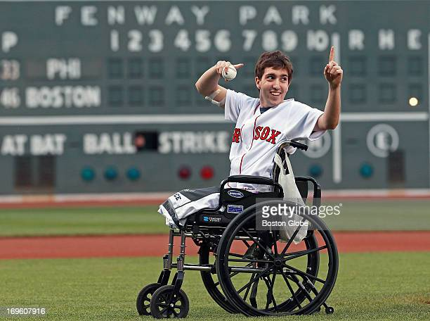 Boston Marathon bombing victim Jeff Bauman threw out a ceremonial first pitch before the game. The Philadelphia Phillies visited the Boston Red Sox...