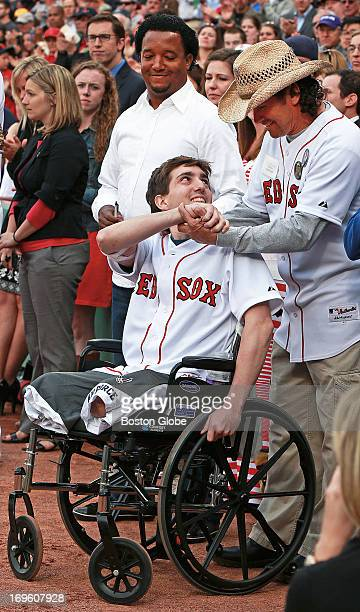 Boston Marathon bombing victim Jeff Bauman threw out a ceremonial first pitch before the game joined by the man credited with saving his life Carlos...