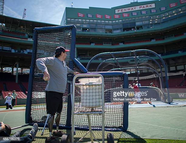 Boston Marathon bombing victim Jeff Bauman throws batting practice for David Ross of the Boston Red Sox before the game against the Baltimore Orioles...