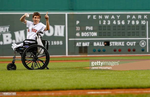 Boston Marathon bombing victim Jeff Bauman throws out the first pitch prior to the interleague game between the Boston Red Sox and the Philadelphia...