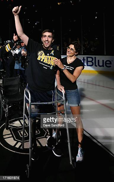 Boston Marathon bombing victim Jeff Bauman waves to the crowd prior to the start of Game Six of the 2013 Stanley Cup Final between the Chicago...