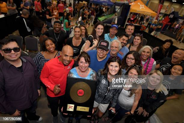 Boston Marathon Champion Meb Keflezighi poses for a photo with Hall of Fame recipient Sherry Ricker at the Health Fitness Expo during Humana Rock 'n'...