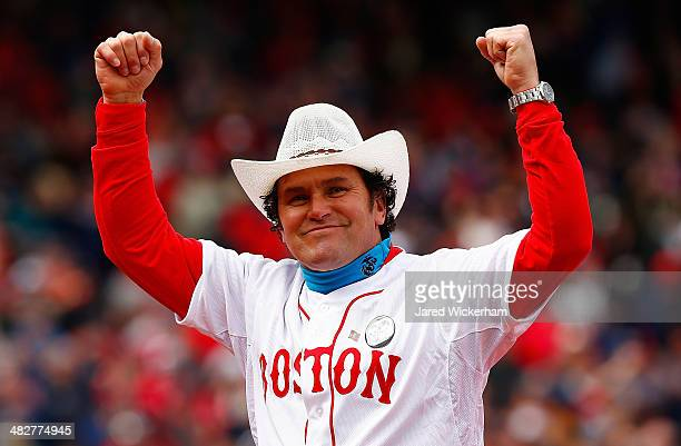 Boston Marathon first responder Carlos Arredondo acknowledges the crowd prior to the Opening Day game between the Boston Red Sox and the Milwaukee...