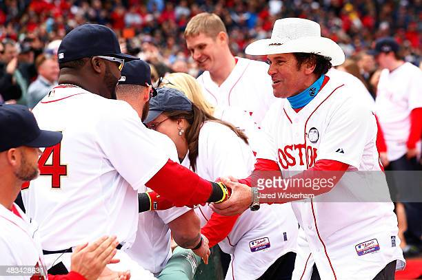 Boston Marathon first responder Carlos Arredondo greets David Ortiz of the Boston Red Sox prior to the Opening Day game between the Boston Red Sox...