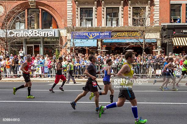 Spectators line the final stretch of the race course to cheer for runners on Boylston Street at same spot where second bomb exploded a year ago