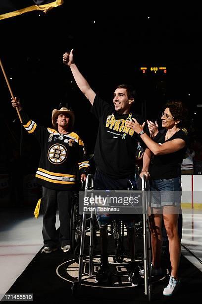 Boston Marathon survivor Jeff Bauman with the man who saved him Carlos Arredondo before the game of the Boston Bruins against the Chicago Blackhawks...