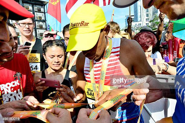 Boston Marathon winner Meb Keflezighi signs autographs for fans at the Suja Rock 'n' Roll San Diego Marathon Half Marathon benefitting the Leukemia...