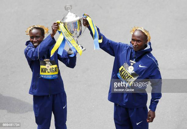 Boston Marathon winners Geoffrey Kirui right and Edna Kiplag pose for photographers at the finish line of the 121st Boston Marathon in Boston on Apr...