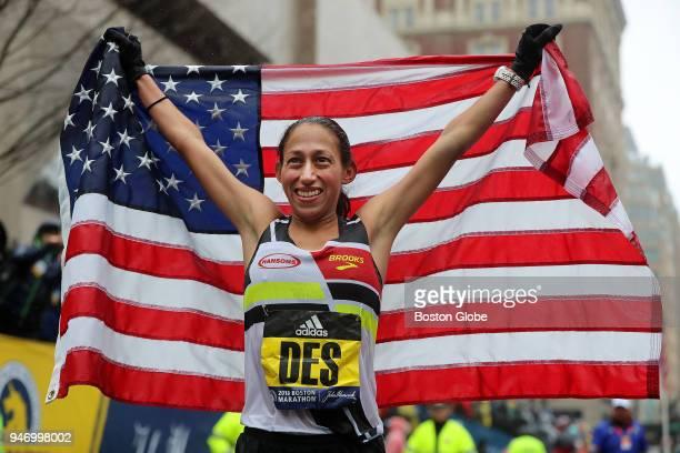 Boston Marathon women's winner Desiree Linden celebrates after she crosses the finish line on April 16 2018