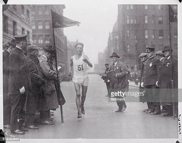 Breaks marathon record Willie Ritola who finished second