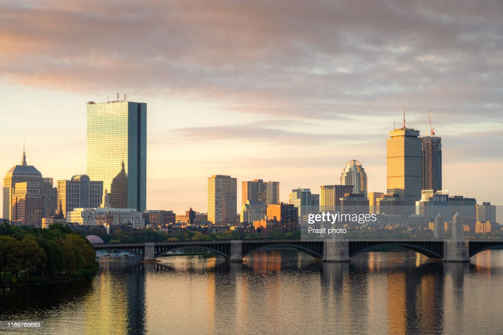 Boston, Massachusetts, USA downtown cityscape from across the Charles River at dawn. : Stock Photo