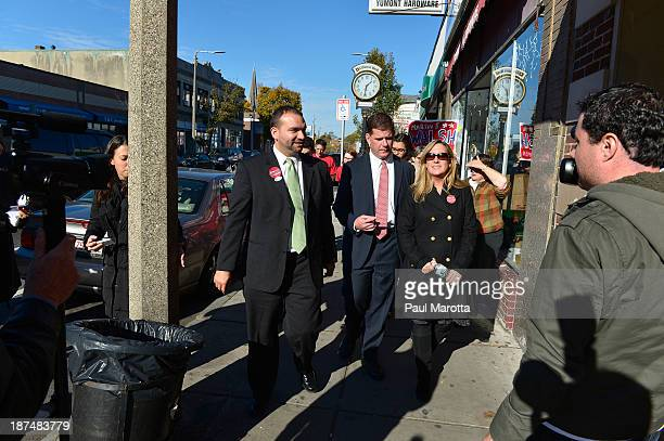 Boston Mayor Elect Marty Walsh and Felix Arroyo meet with campaign supporters and Boston voters on election day in Boston on November 5. Walsh...