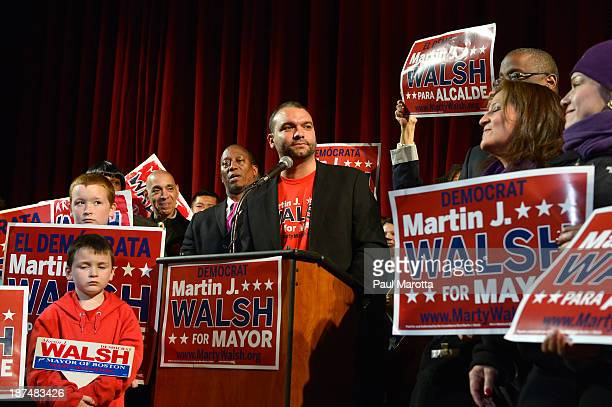 Boston Mayor Elect Marty Walsh is introduced by former Boston Mayoral Candidate Felix Arroyo on Election Eve at a campaign Rally at the Strand...